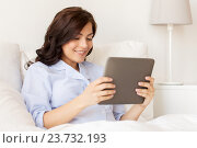 Купить «happy pregnant woman with tablet pc at home», фото № 23732193, снято 20 мая 2016 г. (c) Syda Productions / Фотобанк Лори