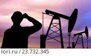 Купить «black silhouette of oil worker and pump jack», фото № 23732345, снято 20 октября 2019 г. (c) Syda Productions / Фотобанк Лори