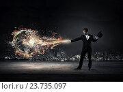 Купить «Businessman demonstrating magic . Mixed media», фото № 23735097, снято 12 марта 2014 г. (c) Sergey Nivens / Фотобанк Лори