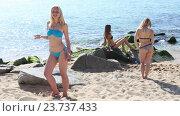 Купить «woman wearing swimwear standing on sandy beach», видеоролик № 23737433, снято 22 июня 2016 г. (c) Яков Филимонов / Фотобанк Лори