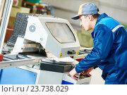 Купить «industrial worker with buzz saw circular blade for cutting metal», фото № 23738029, снято 21 января 2016 г. (c) Дмитрий Калиновский / Фотобанк Лори