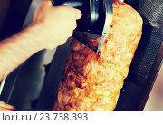 Купить «Closeup on cutting meat for kebab with special knife on kitchen», фото № 23738393, снято 19 октября 2018 г. (c) Яков Филимонов / Фотобанк Лори