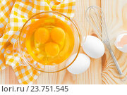 Купить «Raw eggs and whisk», фото № 23751545, снято 19 сентября 2014 г. (c) easy Fotostock / Фотобанк Лори