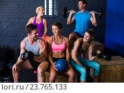 Купить «Happy athletes with exercise equipment», фото № 23765133, снято 24 апреля 2016 г. (c) Wavebreak Media / Фотобанк Лори