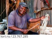Купить «KENYA, AFRICA - DECEMBER 10: A man carving figures in wood.», фото № 23767285, снято 19 августа 2018 г. (c) age Fotostock / Фотобанк Лори