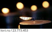 Купить «Close-up of burning candle», видеоролик № 23773453, снято 5 апреля 2020 г. (c) Wavebreak Media / Фотобанк Лори