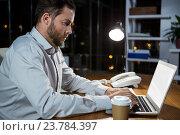 Купить «Businessman working on laptop», фото № 23784397, снято 2 июня 2016 г. (c) Wavebreak Media / Фотобанк Лори