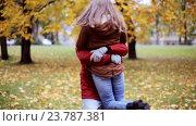Купить «happy young couple meeting in autumn park», видеоролик № 23787381, снято 12 октября 2016 г. (c) Syda Productions / Фотобанк Лори