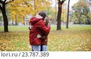 Купить «happy young couple throwing autumn leaves in park», видеоролик № 23787389, снято 12 октября 2016 г. (c) Syda Productions / Фотобанк Лори