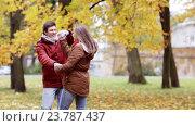 Купить «happy young couple having fun in autumn park», видеоролик № 23787437, снято 12 октября 2016 г. (c) Syda Productions / Фотобанк Лори