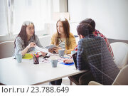 Купить «Editors discussing in meeting room», фото № 23788649, снято 12 апреля 2016 г. (c) Wavebreak Media / Фотобанк Лори