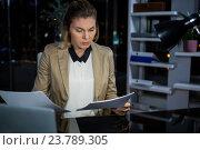 Купить «Businesswoman looking at documents», фото № 23789305, снято 2 июня 2016 г. (c) Wavebreak Media / Фотобанк Лори