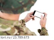 Купить «Soldier using a mobile phone», фото № 23789673, снято 24 июня 2016 г. (c) Wavebreak Media / Фотобанк Лори