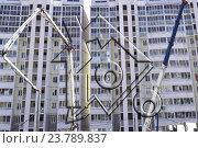 Купить «Прозрачный знак процента на фоне строящегося дома», фото № 23789837, снято 3 мая 2016 г. (c) Сергеев Валерий / Фотобанк Лори