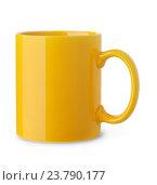 Купить «Желтая чашка на белом фоне», фото № 23790177, снято 7 сентября 2016 г. (c) Антон Стариков / Фотобанк Лори