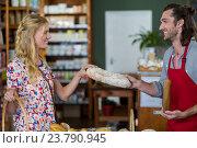 Купить «Smiling male staff giving loaf of bread to woman», фото № 23790945, снято 17 мая 2016 г. (c) Wavebreak Media / Фотобанк Лори