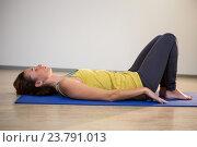 Купить «Woman performing yoga exercise», фото № 23791013, снято 28 апреля 2016 г. (c) Wavebreak Media / Фотобанк Лори