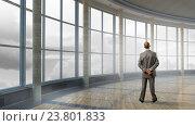 Купить «Pensive businessman in office . Mixed media», фото № 23801833, снято 19 июня 2019 г. (c) Sergey Nivens / Фотобанк Лори