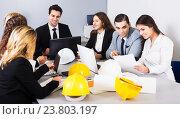 Купить «Team of discussing engineers», фото № 23803197, снято 7 декабря 2019 г. (c) Яков Филимонов / Фотобанк Лори