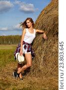 Купить «Young blonde country girl in hat near haystack», фото № 23803645, снято 8 сентября 2016 г. (c) Serg Zastavkin / Фотобанк Лори