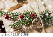 Купить «close up of christmas gift with fir brunch», фото № 23815389, снято 7 октября 2015 г. (c) Syda Productions / Фотобанк Лори