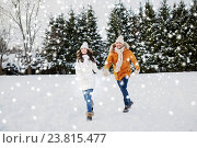 Купить «happy couple running in winter snow», фото № 23815477, снято 23 января 2016 г. (c) Syda Productions / Фотобанк Лори