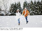 Купить «happy couple running in winter snow», фото № 23815477, снято 23 января 2016 г. (c) Syda Productions / Фотобанк Лори