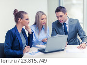 Купить «business team with laptop having discussion», фото № 23815749, снято 9 ноября 2013 г. (c) Syda Productions / Фотобанк Лори