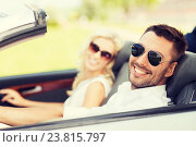 Купить «happy man and woman driving in cabriolet car», фото № 23815797, снято 15 июля 2015 г. (c) Syda Productions / Фотобанк Лори