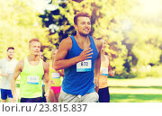 Купить «happy young sportsmen racing wit badge numbers», фото № 23815837, снято 16 августа 2015 г. (c) Syda Productions / Фотобанк Лори