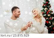 Купить «man giving engagement ring to woman for christmas», фото № 23815929, снято 8 октября 2015 г. (c) Syda Productions / Фотобанк Лори