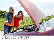 Купить «women with open hood of broken car at countryside», фото № 23816097, снято 28 мая 2016 г. (c) Syda Productions / Фотобанк Лори