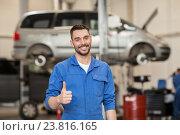 Купить «happy auto mechanic man or smith at car workshop», фото № 23816165, снято 1 июля 2016 г. (c) Syda Productions / Фотобанк Лори