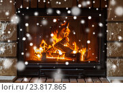 close up of burning fireplace with snow. Стоковое фото, фотограф Syda Productions / Фотобанк Лори