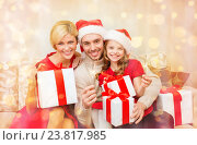 Купить «smiling family holding gift boxes and sparkles», фото № 23817985, снято 26 октября 2013 г. (c) Syda Productions / Фотобанк Лори