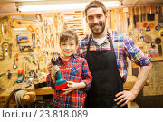 Купить «father and son with drill working at workshop», фото № 23818089, снято 14 мая 2016 г. (c) Syda Productions / Фотобанк Лори
