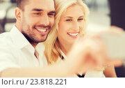 happy couple taking selfie with smatphone outdoors, фото № 23818221, снято 15 июля 2015 г. (c) Syda Productions / Фотобанк Лори