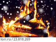 Купить «close up of firewood burning in fireplace and snow», фото № 23818269, снято 16 октября 2015 г. (c) Syda Productions / Фотобанк Лори
