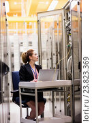 Купить «Technician using laptop while analyzing server», фото № 23823369, снято 13 апреля 2016 г. (c) Wavebreak Media / Фотобанк Лори