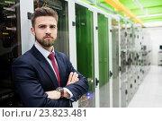 Купить «Technician standing with arms crossed in a server room», фото № 23823481, снято 13 апреля 2016 г. (c) Wavebreak Media / Фотобанк Лори