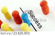 Купить «Multicolored figurines on a paper with text success», видеоролик № 23825853, снято 5 апреля 2020 г. (c) Wavebreak Media / Фотобанк Лори