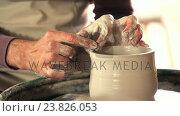 Купить «Mid section of potter making pot», видеоролик № 23826053, снято 5 апреля 2020 г. (c) Wavebreak Media / Фотобанк Лори