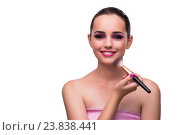Купить «Woman getting make-up isolated on white», фото № 23838441, снято 22 августа 2016 г. (c) Elnur / Фотобанк Лори