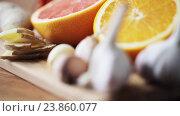 Купить «ginger, grapefruit, orange and garlic on board», видеоролик № 23860077, снято 18 октября 2016 г. (c) Syda Productions / Фотобанк Лори