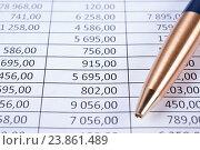 Купить «Шариковая ручка лежит на таблице с цифрами», фото № 23861489, снято 18 сентября 2016 г. (c) Андрей Липинский / Фотобанк Лори