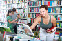 girl teenager choosing book in shop, фото № 23901441, снято 16 сентября 2016 г. (c) Яков Филимонов / Фотобанк Лори