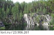 Купить «Talc Stone - lake in old mining quarry and local landmark in Ural», видеоролик № 23906261, снято 3 сентября 2016 г. (c) Serg Zastavkin / Фотобанк Лори