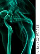 Купить «Клубы изумрудного дыма на черном фоне», фото № 23907185, снято 12 марта 2016 г. (c) Pavel Biryukov / Фотобанк Лори