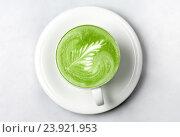 cup of matcha green tea latte over white. Стоковое фото, фотограф Syda Productions / Фотобанк Лори