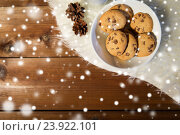 close up of cookies in bowl and cones on fur rug. Стоковое фото, фотограф Syda Productions / Фотобанк Лори